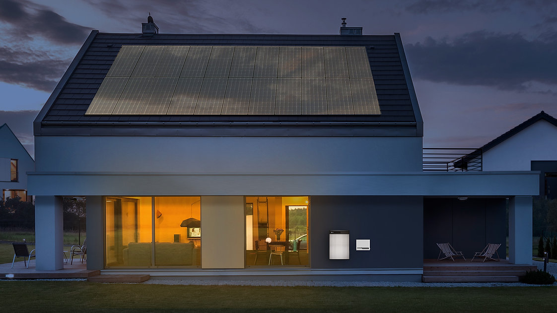 LG RESU6.5 and inverter dark solar panel home outside.jpg