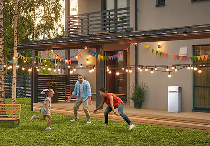 Happy family outside with LG RESU16H Prime