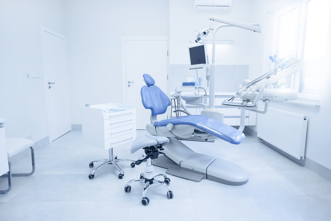 Modern dental practice. Dental chair and other accessories used by dentists in blue, medic
