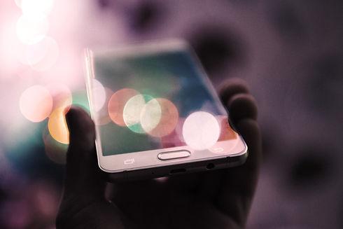 person holding smartphone_edited.jpg