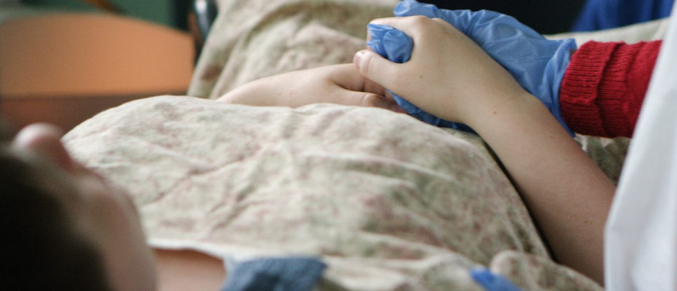 Patient-and-hand-holding-1300x650.jpg
