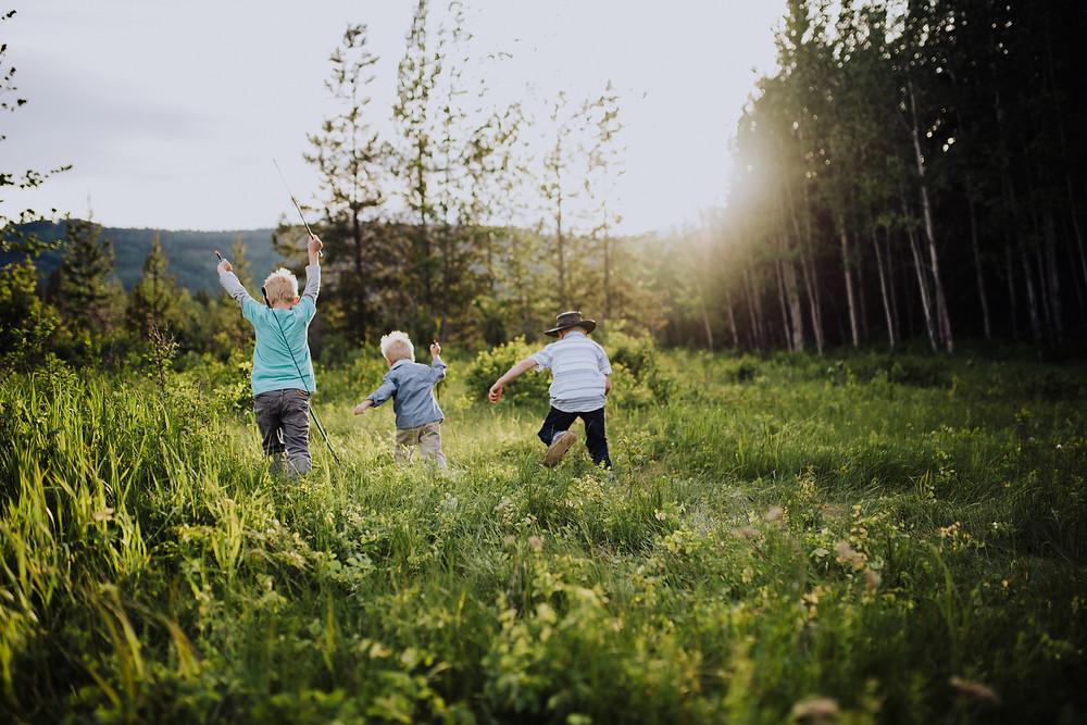 Salmon Arm Photographer three boys running through field