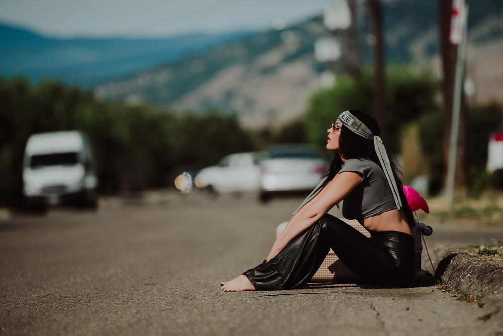 woman sitting on side of road Salmon Arm Branding Photographer