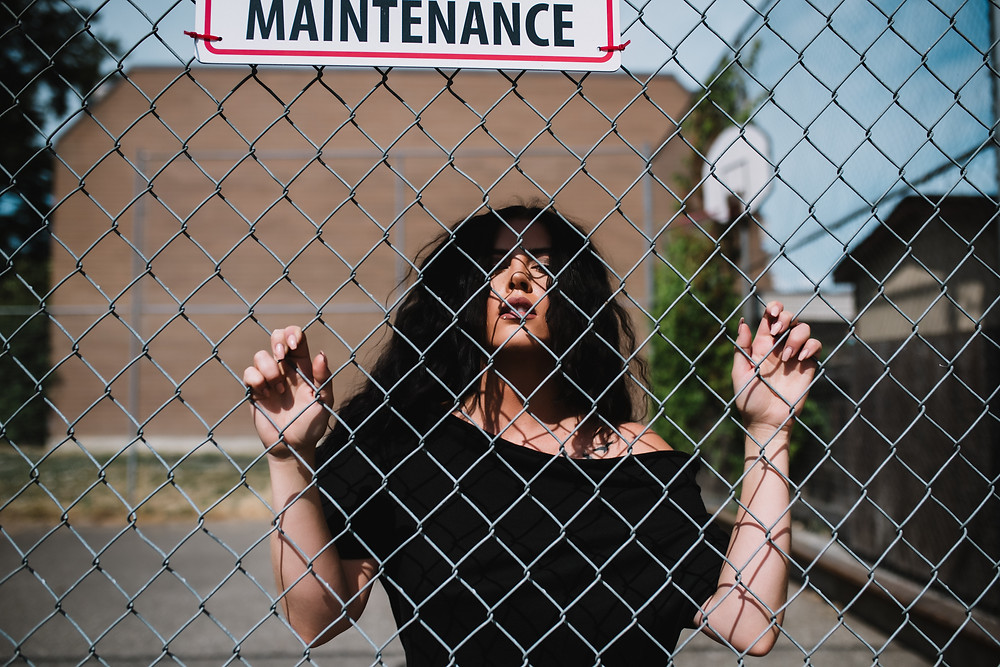 Woman in black dress behind fence Salmon Arm Business Photographer