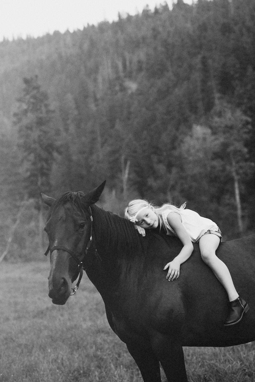 Salmon Arm Photographer little blonde girl on black horse