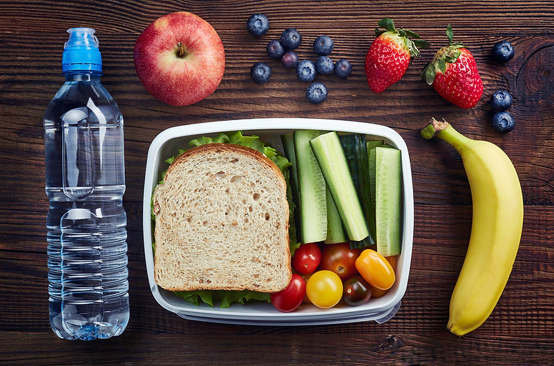 Healthy lunch box with sandwich and fres