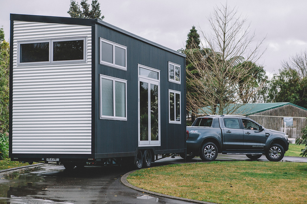 Build Tiny's Millennial Tiny House being towed.