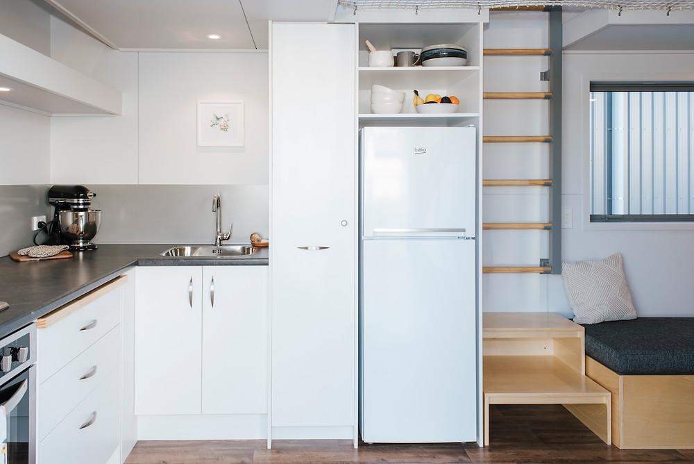 Larissa & Tyler's tiny house kitchen built by Build Tiny