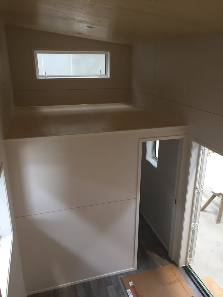 View of the Archers second loft and door into the down stairs bathroom.