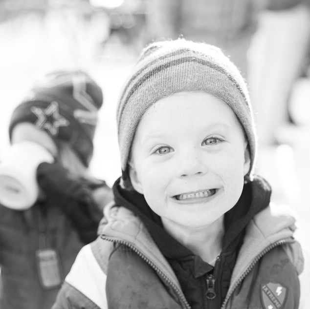 A kid smiling in BNW