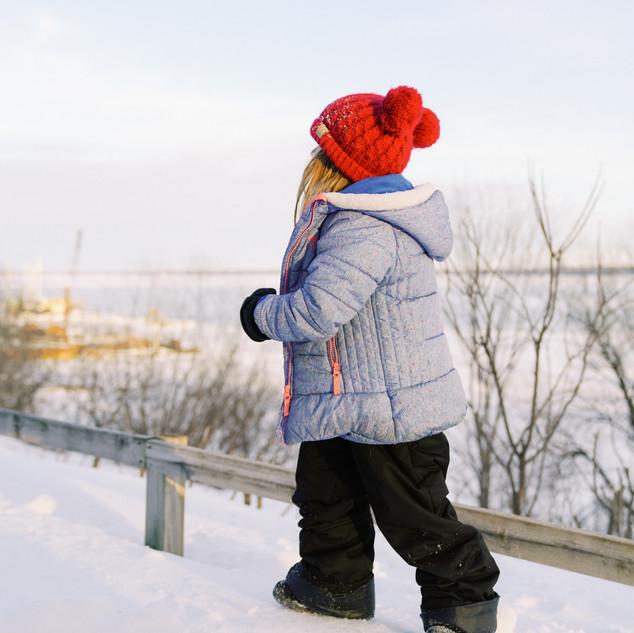 A kid walking in snow
