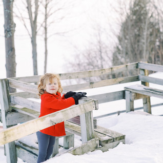 A kid posing in snow