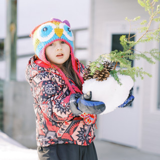 A kid holding snow