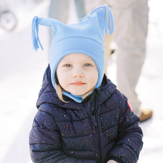 A kid with a blue hat