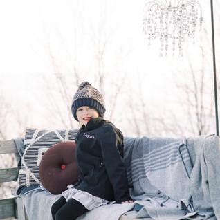A kid sitting down