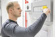 Technician test fire panel in data cente