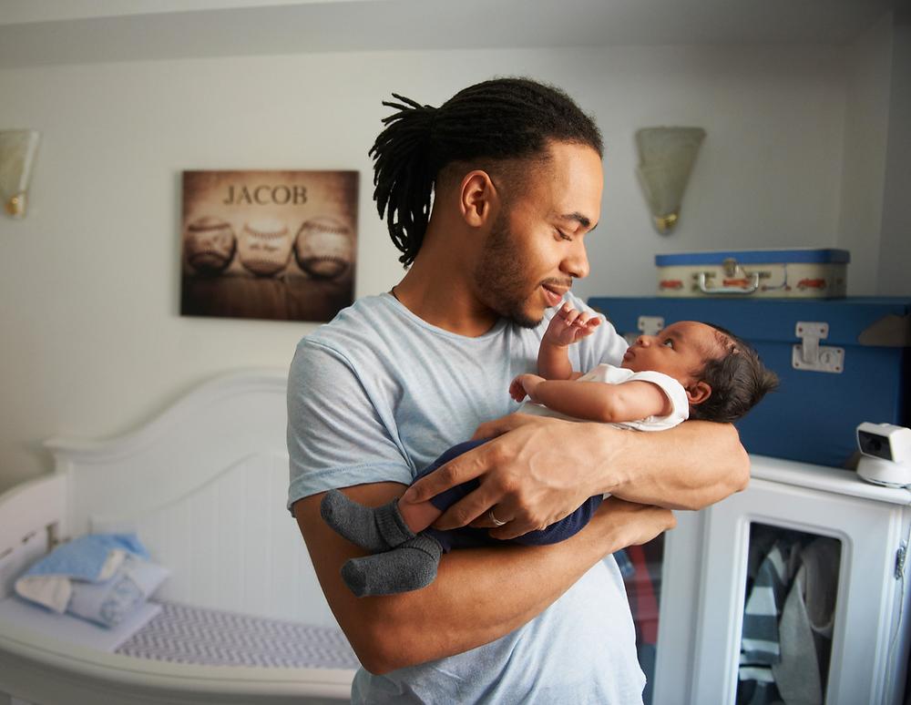 dad, daddy, newborn baby, dad-carrying-newborn, new dad, newborn baby, new baby, dad in nursery