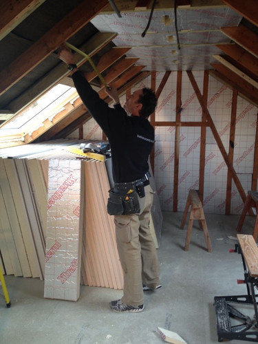 John fitting insulation and plasterboard