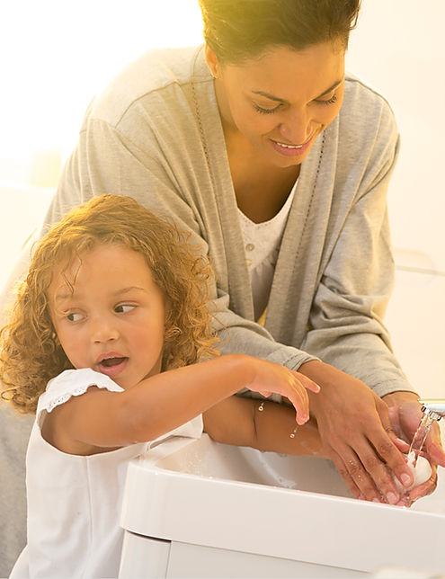 little girl and mum using basin