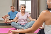 Senior couple with trainer sitting in lo