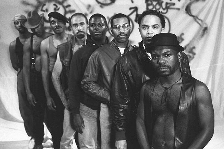 """In this production still from the 1989 documentary Tongues Untied, late filmmaker Marlon Riggs, a former Berkeley Journalism professor and alumnus, stands at the front of a line of Black men. At the end of the film, words flash on the screen: """"Black men loving Black men is the revolutionary act."""" (Image courtesy of Signifyin' Works)"""