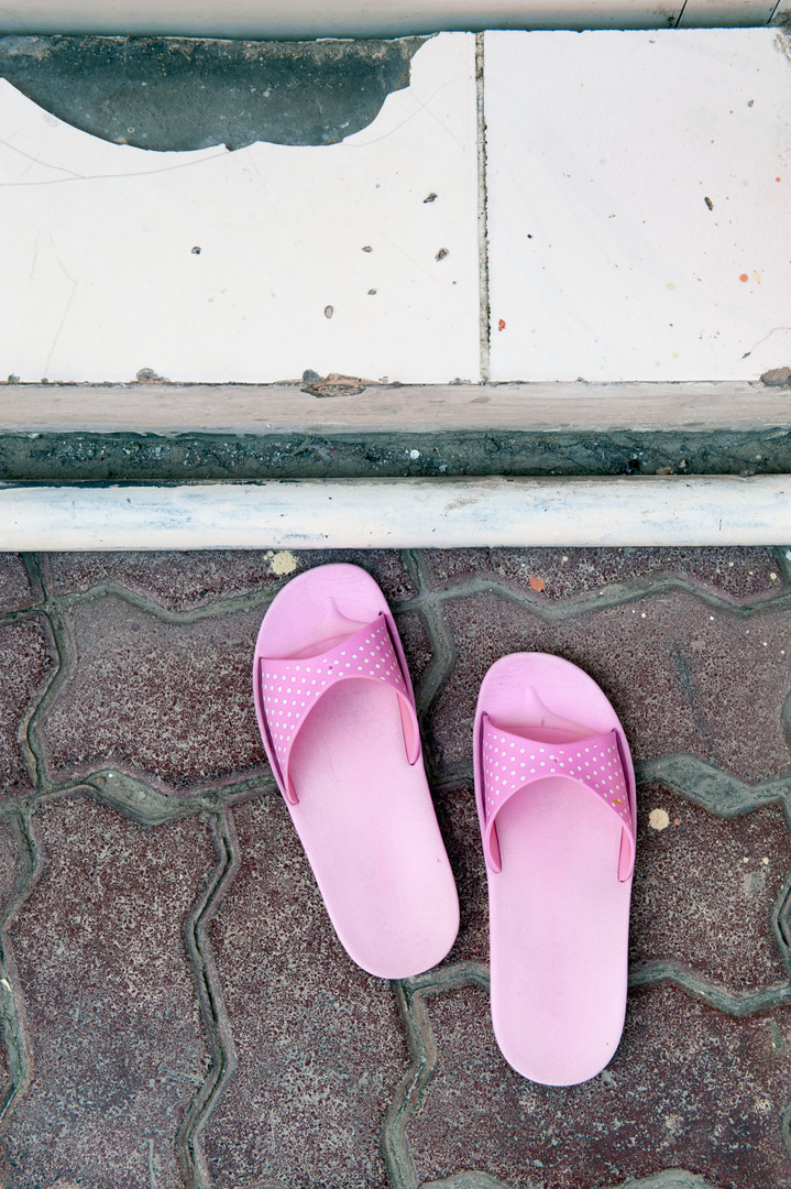 Theresa's office hours often are 24/7 and as soon as her pink outdoor slippers are seen resting by the entrance to her room, labourer women arrive seeking advice, assistance or support.
