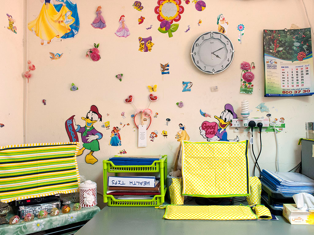 Theresa chooses vivid colours and blithe cartoon character stickers to decorate her room which serves as a living space as well as office.
