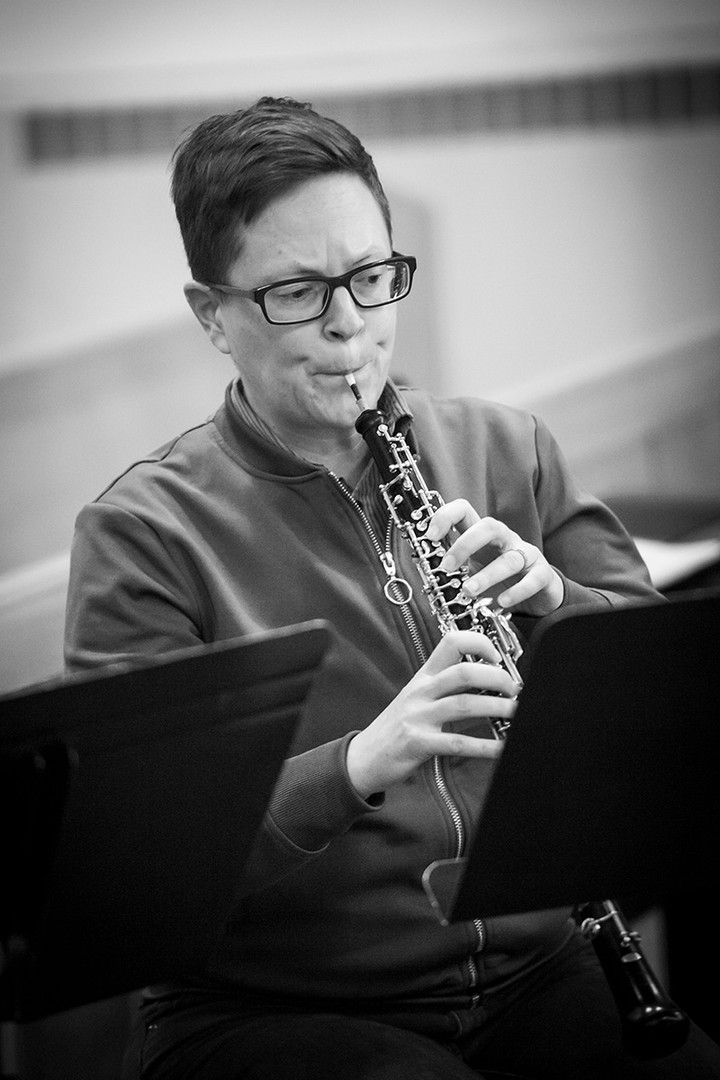 Oboist performing at rehearsal.