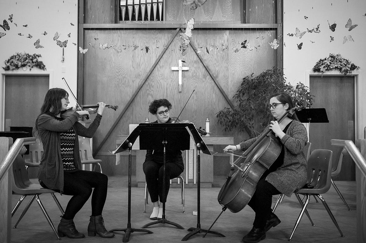 String trio rehearsing in St.John's.