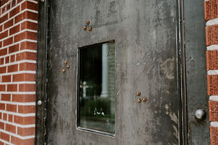 Bullet riddled door at The Bank