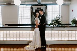 bride & groom in front of Art Deco bar