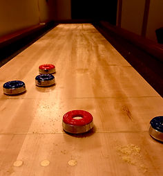 shuffleboard table in the Hideout at The Bank