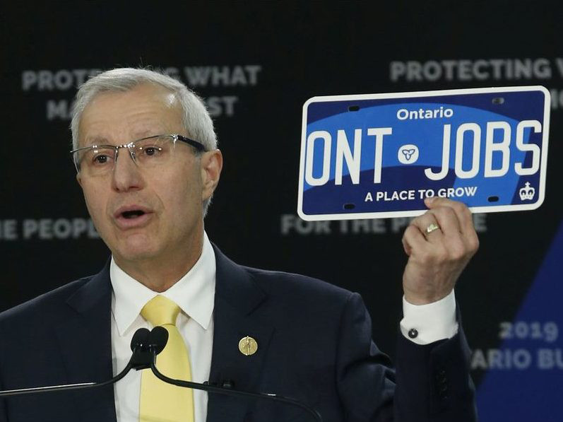 Ontario Finance Minister Vic Fedeli unveils Ontario's new plate design.