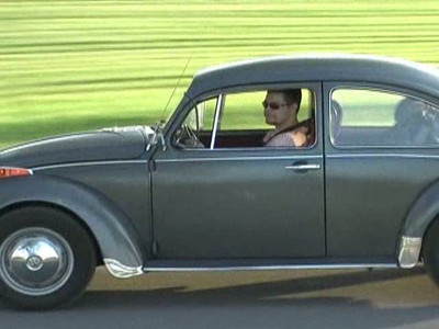 A still capture from a video my dad shot of Greta going for a run through the central Ottawa farm. It's the only picture I have of me actually driving Greta.