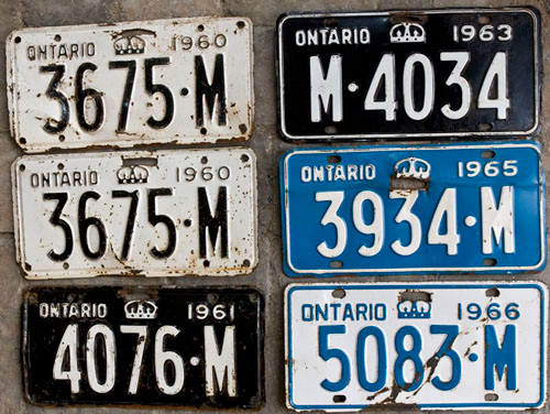 "1963 is an odd year for Ontario dealer plates, in that the ""M"" was moved to the leading position, inexplicably, for one year only."