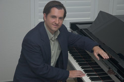 Me at piano seated