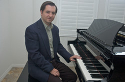 Me at piano seated 2