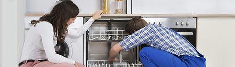 Technician Working on Dishwasher