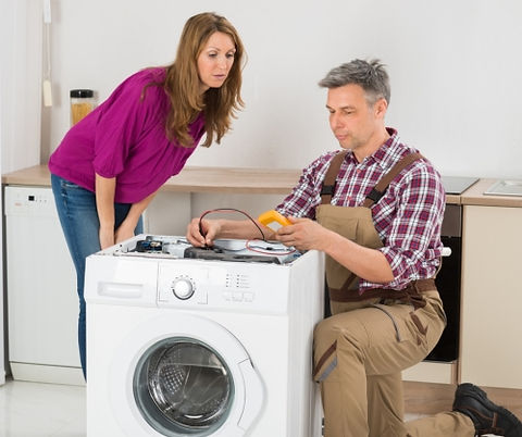 Technician Working on Washer