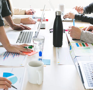 hands-on-desk-at-meeting.jpg
