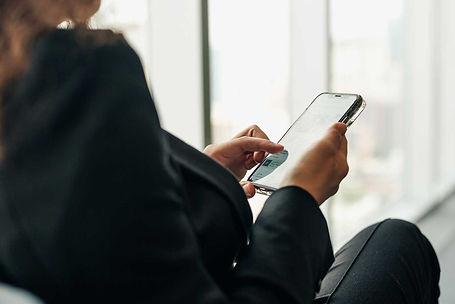 woman-holding-phone-browsing-social-medi