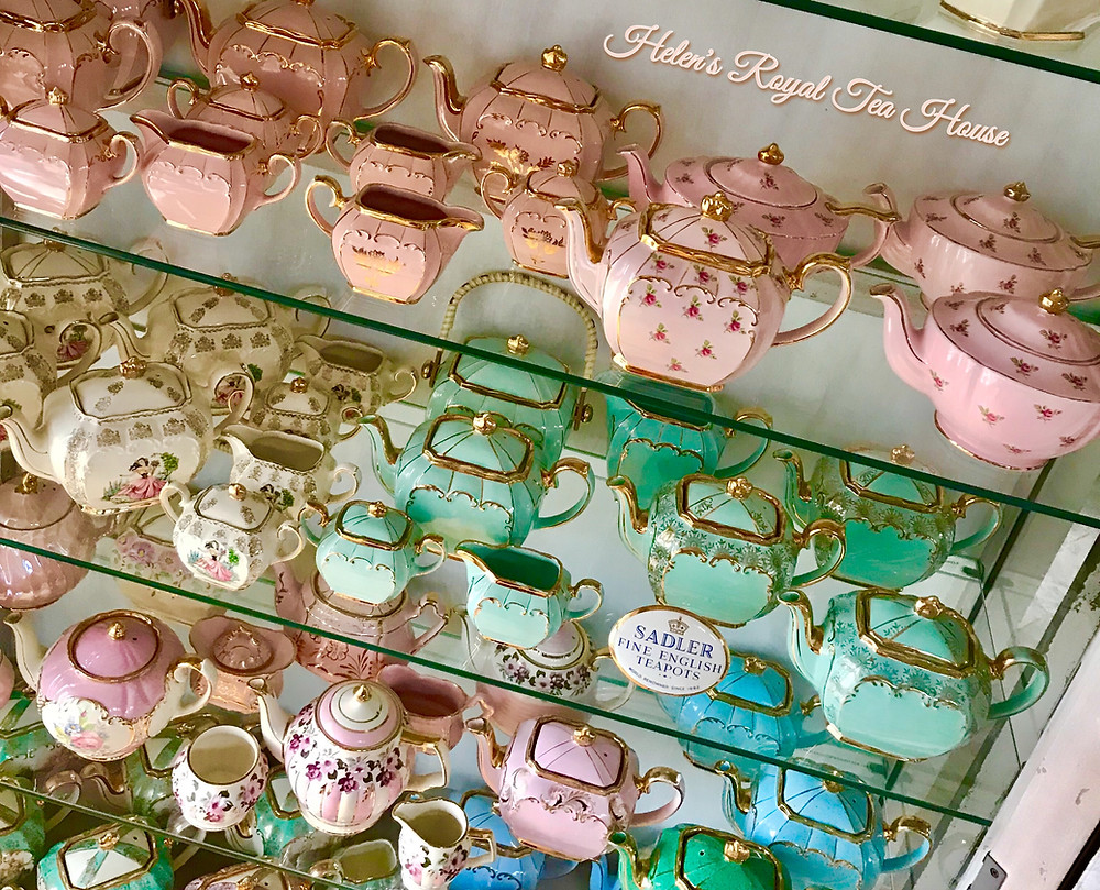 Teapots in a cabinet