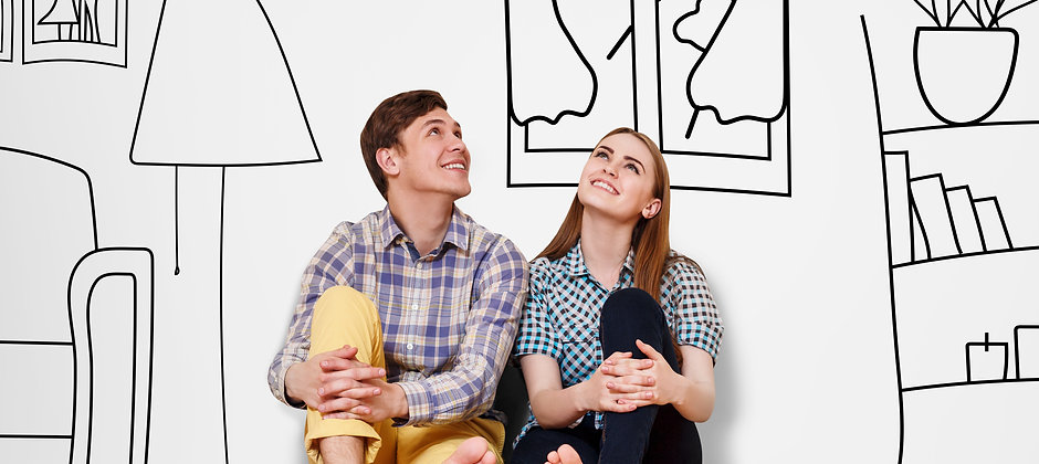 Young happy couple sitting on the floor
