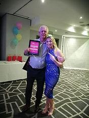 Adrian holding award
