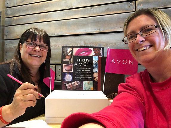 Two Avon Representatives at work