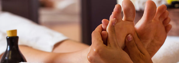 Massage of human foot in spa salon - Sof