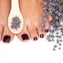 Closeup photo of a female feet with pedi