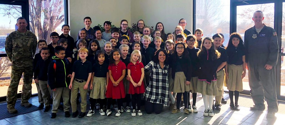 Soldiers and the Faith Academy students