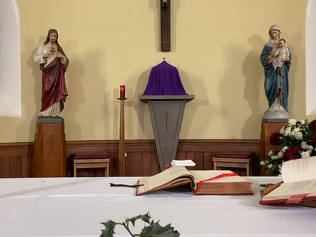 Praying for the repose of the souls of Bishop Vincent Logan and Archbishop Philip Tartaglia