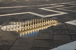 The Procuratie Vecchie Reflected in the Piazza